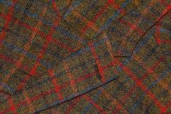 Fragment of old tweed jacket as a background Royalty Free Stock Image