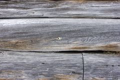 Fragment of the old village barn. Wood texture Stock Image