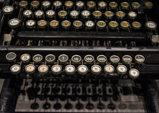 The fragment of old and vintage adding machine Stock Photos