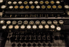 The fragment of old and vintage adding machine Stock Images