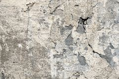 Fragment of the old wall with decaying and fallen off plaster royalty free stock images