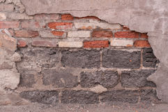 Fragment of old wall with layers of plaster Royalty Free Stock Photography