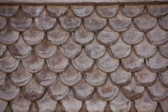 Fragment of the old wall, similar to shingles Royalty Free Stock Photography