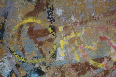 Fragment of old wall texture with peeling paint graffiti Royalty Free Stock Photo