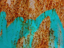Fragment of old wall texture with peeling paint graffiti Royalty Free Stock Image