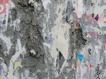 Fragment of old wall texture with traces of many layers of torn posters and announcements Stock Photography