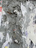 Fragment of old wall texture with traces of many layers of torn posters and announcements Stock Photo