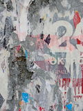 Fragment of old wall texture with traces of many layers of torn posters and announcements Royalty Free Stock Image