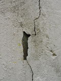 Fragment of old wall texture with vertical crack in plaster Royalty Free Stock Photo