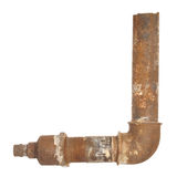 A fragment of the old water conduit consisting of pipes and fitt Royalty Free Stock Photos