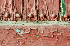 old weather-beaten red door, surface with chapped textured paint Stock Image
