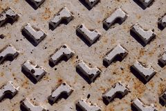 Fragment of an old white metal surface with geometrical figures with spots of rust and damage. stock photos
