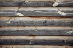 Fragment of old wood wall. Fragment of old darkened wood wall with the gnarls stock photo