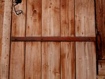 A fragment of an old wooden barn door stock photography