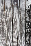 Fragment of old wooden boards with peeling white paint, background Royalty Free Stock Photography