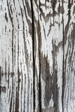 Fragment of old wooden boards with peeling white paint, background Royalty Free Stock Images