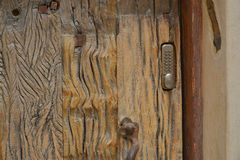 A fragment of the old wooden door Stock Photo