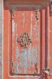 Fragment of an old wooden door. Background of old painted boards. A common old door with a pattern Stock Photos