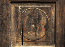 Fragment of old wooden door Brown. Background Stock Photos