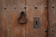 Fragment of old wooden door with handle Stock Photo