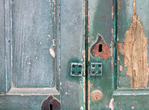 Fragment of old wooden door with keyhole and door lock close-up Stock Photo