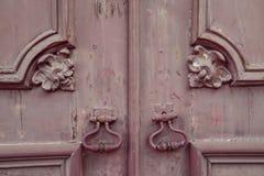 Fragment of old wooden door with metal knob Stock Image
