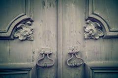 Fragment of old wooden door with metal knob Stock Photos