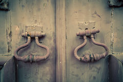 Fragment of old wooden door with metal knob Royalty Free Stock Image