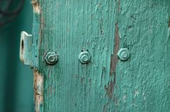 Fragment of an old wooden door. Painted turquoise paint Stock Images