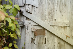 Fragment of an old wooden door. Fragment of old wooden door with rusty handle Royalty Free Stock Images