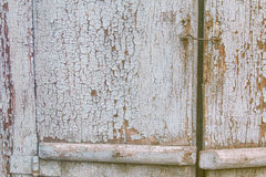 Fragment of an old wooden door. Fragment of old wooden door with rusty handle Stock Photography