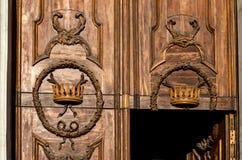 Fragment of old wooden door. Saint-Petersburg. Old wooden door in Church of St. Catherine on Nevsky Prospekt in Saint Petersburg. Decorative crown carving Stock Photography