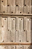 Fragment of old wooden door to the church. Radegund at Poitiers Royalty Free Stock Image
