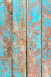 Fragment of old wooden fence. With cracked paint stock image