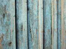 Fragment of an old wooden fence made of boards Royalty Free Stock Image