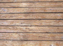 Fragment of an old wooden fence made of unpainted boards Stock Image