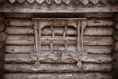 Fragment of old wooden house. Toned Stock Photos