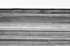 Fragment of old wooden house. Fragment of old wooden house in Vologda, Russia. Black and white Royalty Free Stock Photos