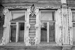 Fragment of old wooden house. Fragment of old wooden house in Vologda, Russia. Black and white Stock Images
