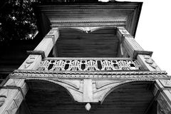 Fragment of old wooden house. Fragment of old wooden house in Vologda, Russia. Black and white Stock Image