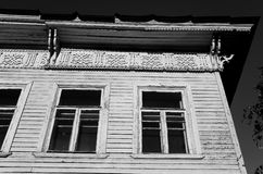 Fragment of old wooden house. Fragment of old wooden house in Vologda, Russia. Black and white Royalty Free Stock Image