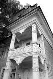 Fragment of old wooden house. Fragment of old wooden house in Vologda, Russia. Black and white Stock Photos