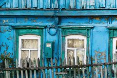 Fragment of an old wooden house with windows. Fragment of an old wooden house with windows Royalty Free Stock Images