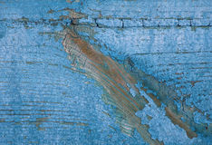 Fragment of the old wooden plank with peeling paint, macro Royalty Free Stock Image