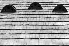 Fragment of old wooden roof of the house Stock Photos