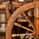 Fragment of old wooden spinning wheel Royalty Free Stock Photography