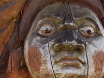 A fragment of an old wooden statue damaged by the time and nature royalty free stock photo
