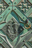 Fragment old wrought iron door, knocker - Cracow, Poland- Saint Mary Basilica-Mariacki Church. Part of richly decorated wrought bronze door-green patina Stock Photo