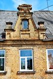 Fragment of old yellow brick house royalty free stock photography