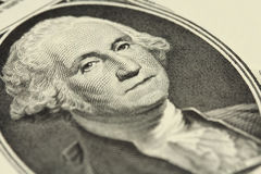 A fragment of one dollar bill with a portrait of President Stock Images